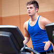 Royalty-Free Stock Photo: Concentrated athletic man training on a running machine