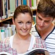 Stock Photo: Young caucasicouple reading book
