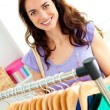 Smiling woman selecting items — Stock Photo