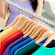 Close-up of clothes with a female customer - Stok fotoğraf