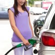 Pretty caucasian woman refueling her car — Stock Photo