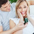 Woman surprised by her boyfriend presents — Stock Photo