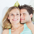 Loving yog couple lying on a sofa — Stock Photo