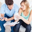 Caucasian couple making calculation - Stock Photo