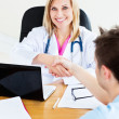 Royalty-Free Stock Photo: Smiling doctor shaking the hand of her patient