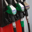 Gasoline pumps nozzles at petrol station - Stock Photo