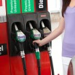 Young woman at the pump - Foto Stock