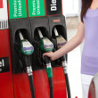 Young woman at the pump - Stock fotografie