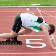 Athletic man on the starting line putting his foot in the starti — Foto de Stock