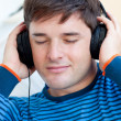 Portrait of a caucasian man listening music closing his eyes — Stock Photo