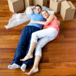 Stock Photo: Young couple lying on floor