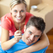 Stock Photo: Young couple holding a key