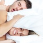 Couple lying on bed — Stock Photo