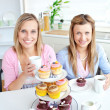 Royalty-Free Stock Photo: Portrait of two female friends eating pastries and drinking coff