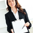 Portrait of a charismatic hispanic businesswoman holding a clipb — Stock Photo