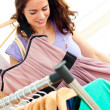 Radiant hispanic woman looking for clothes — Stock Photo
