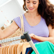 Cute hispanic woman looking for clothes — Stock Photo
