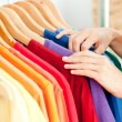 Close-up of a female hispanic customer looking for clothes — Stock Photo
