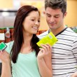 Delighted couple buying products — Stock Photo