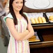 Self-assured female cook smiling at the camera in front of her b — Stock Photo