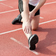 Male sprinter warming up — Stock Photo
