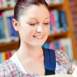 Positive young caucasian woman reading a book — Stock Photo