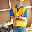 Stock Photo: Confident male worker holding a clipboard