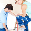 Beautiful couple painting a room — Stock Photo