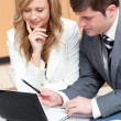 Two businesspeople working on a presentation — Stock Photo