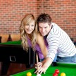 Young couple playing pool — Stock Photo #10837266