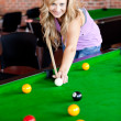 Bright woman playing pool — Stock Photo