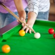 Attentive boyfriend learning his girlfriend how to play pool — Stock Photo