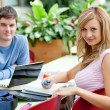 Stock Photo: Smiling couple of students working together