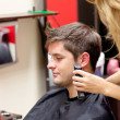 Young caucasian man being shaved — Stockfoto