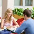 Delighted couple of students working together in the cafeteria — Stock Photo #10837446