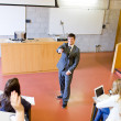 Charismatic teacher giving a lesson to university students — Stock Photo #10837458