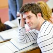 Bored male student during an university lesson — Stock Photo