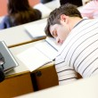 Asleep male student during an university lesson — Stock Photo #10837478
