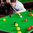 Stock Photo: Concentrated young mplaying snooker