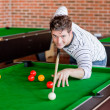 Assertive young man playing snooker — Stock Photo