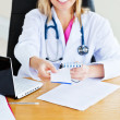 Royalty-Free Stock Photo: Close-up of a beautiful doctor giving a prescription to a patien