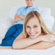 Portrait of a beautiful woman relaxing on the sofa with her boyf — Stock Photo