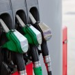 Close-up of gasoline pumps nozzles in petrol station — Stock Photo #10838002