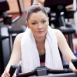 Serious athletic woman pedaling during a training in a sport cen — Stock Photo #10838050