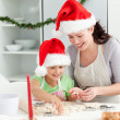 Stock Photo: Lovely mother and daughter preparing Christmas cookies