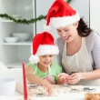 Lovely mother and daughter preparing Christmas cookies — Stock Photo