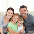 Portrait of a happy family at home — Stok fotoğraf