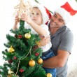 Father and son decorating their christmas tree — Foto Stock
