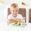 Cute little boy ready to eat his salad for lunch sitting at a ta — Stock Photo #10838661