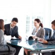 Stock Photo: Four business during meeting